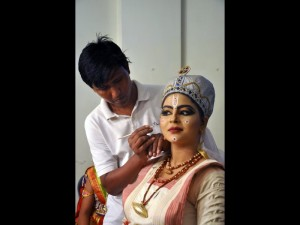 The traditional costume and make up of Sutradhar or narrator in Sattriya dance drama