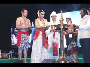 Krishnakshi lighting of the lamp in BHARATHEEYAM 2014 with Guru Ramkrishna Talukdar and in presence of noted singer Yesudas